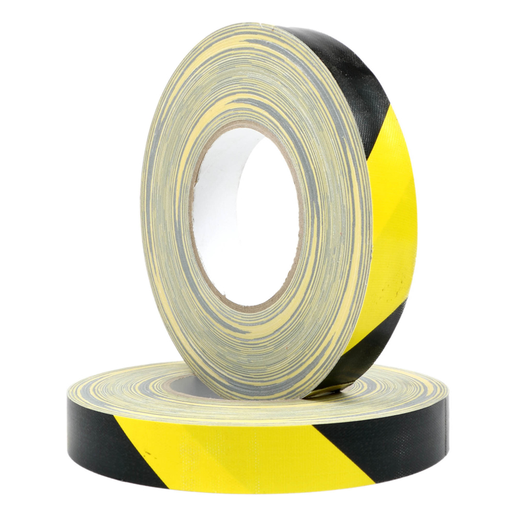 """Picture of BLACK AND YELLOW STRIPED HAZARD  1"""" Route Setting Tape"""